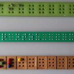 Prisma rectangular, dirigido en varios cajetines separados entre sí por líneas en relieve. Cada cajetin contiene seis agujeros, para introducir pivotes y facilitar el aprendizaje del sistema braille.